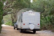 camper-trailer-entering-campsite-38282260